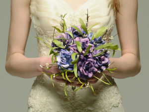 purple sheet music and feather bouquet